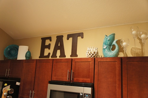 Decorating above the kitchen cabinets little lessons in a big city - Decor over kitchen cabinets ...
