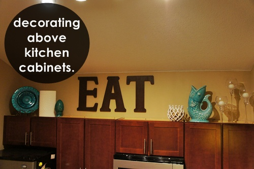 Decorating Tops Of Kitchen Cabinets decorating above the kitchen cabinets. | little lessons in a big city